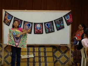 Holly Rauen using the Moon Goddess flag as a teaching aid for health education for the Mayan women.